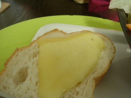 Another way to eat is to slide the cheese on top of your bread, like Heidi's grandad does
