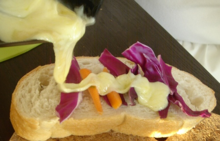 Or arrange the veggies first on the bread, then seal the sandwich by pouring the cheese on top