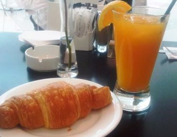 Yummy flakey buttery croissant with freshly squeezed orange juice....