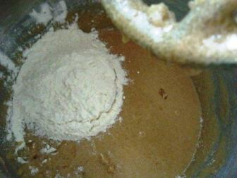 Add 3 cups of flour gradually... and mix
